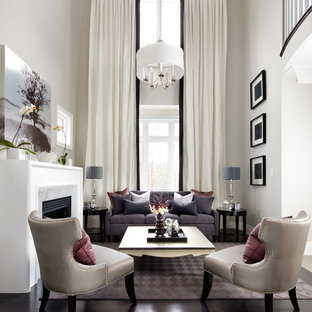 Example of a mid-sized transitional formal living room design in Toronto with beige walls and a standard fireplace