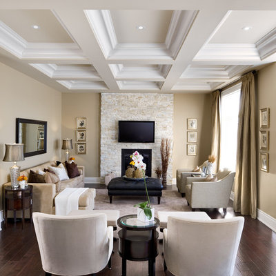 Inspiration for a timeless enclosed brown floor living room remodel in Toronto with a stone fireplace, a standard fireplace and a wall-mounted tv