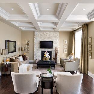 トロントのトラディショナルスタイルのおしゃれな独立型リビング (石材の暖炉まわり、標準型暖炉、壁掛け型テレビ、茶色い床) の写真