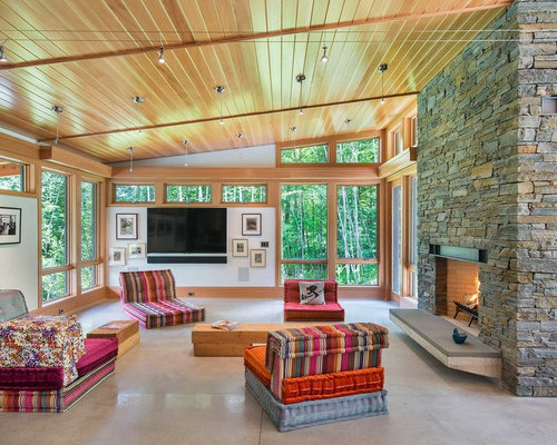 Inspiration For A Contemporary Open Concept Living Room Remodel In Burlington With White Walls Concrete