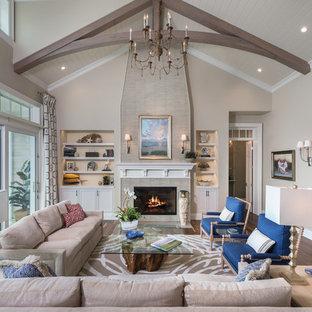 Idee per un grande soggiorno costiero aperto con sala formale, pareti beige, parquet scuro, camino classico e nessuna TV