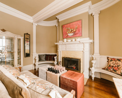 example of a classic formal and enclosed medium tone wood floor living room design in chicago