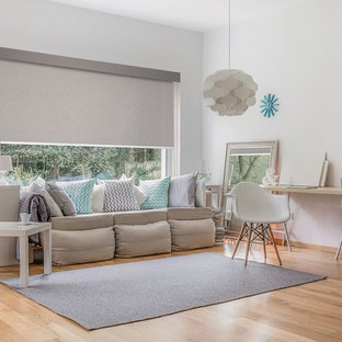 Photo of a large scandinavian formal open concept living room in Other with white walls, light hardwood floors, no tv and brown floor.