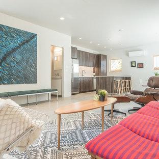 ソルトレイクシティの中サイズのミッドセンチュリースタイルのおしゃれなLDK (テレビなし、グレーの床、フォーマル、ベージュの壁、コンクリートの床、暖炉なし) の写真