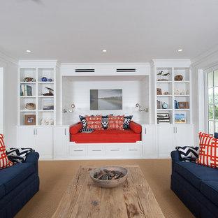 ボストンの大きいビーチスタイルのおしゃれな独立型リビング (白い壁、カーペット敷き、暖炉なし、テレビなし、ベージュの床) の写真