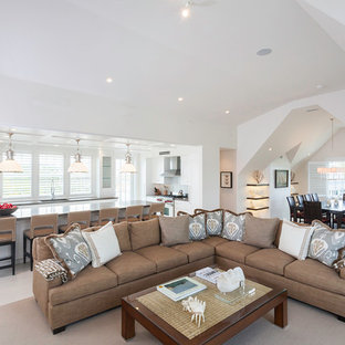 Large nautical open plan living room in Boston with white walls and no tv.
