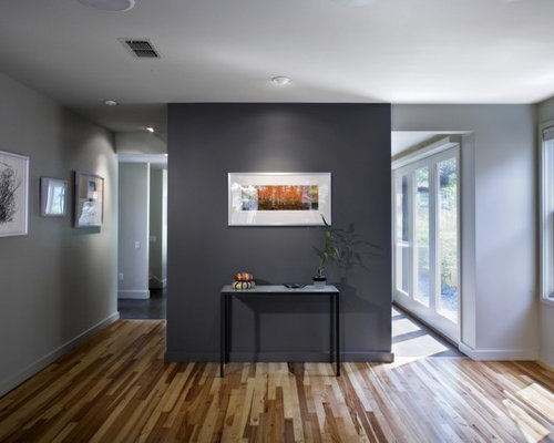 Example Of A Small Trendy Medium Tone Wood Floor Living Room Design In Austin With Gray