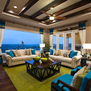 This is an example of a large traditional living room in Austin with beige walls.