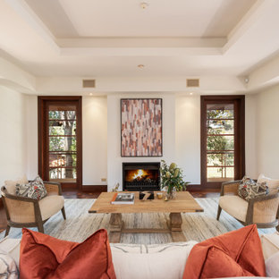 Photo of a large contemporary formal enclosed living room in Brisbane with white walls, no tv and brown floor.