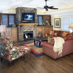 Inspiration for a timeless living room remodel in Omaha with a stone fireplace