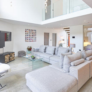 This is an example of a contemporary formal living room in West Midlands with white walls and grey floors.