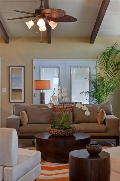 Tropical Living Room by Julie Sumile Interior Design