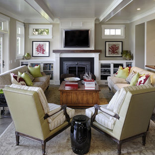 Living room - large traditional living room idea in Seattle with beige walls, a standard fireplace and a wall-mounted tv