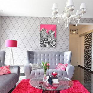 Esempio di un soggiorno design di medie dimensioni e aperto con pareti grigie, pavimento in gres porcellanato e pavimento nero