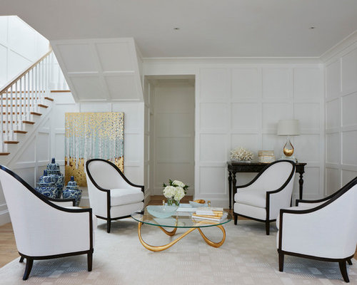 coastal formal and open concept light wood floor living room photo in miami with white walls
