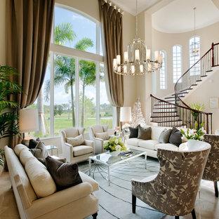 Foto di un grande soggiorno classico aperto con pareti beige, pavimento in marmo, sala formale e nessuna TV