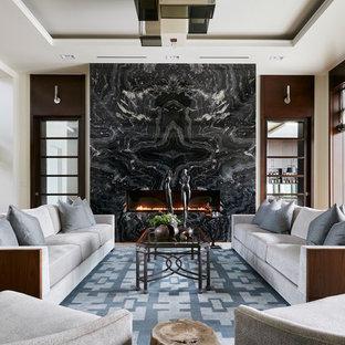 マイアミの大きいモダンスタイルのおしゃれなLDK (フォーマル、白い壁、淡色無垢フローリング、横長型暖炉、石材の暖炉まわり、テレビなし) の写真