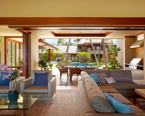 Inspiration for a tropical open concept living room remodel in Hawaii with  yellow walls and slateTropical Living Room with Yellow Walls Ideas   Design Photos   Houzz. Tropical Living Room Design. Home Design Ideas