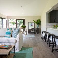 Tropical Living Room by Barker Kappelle Construction, LLC