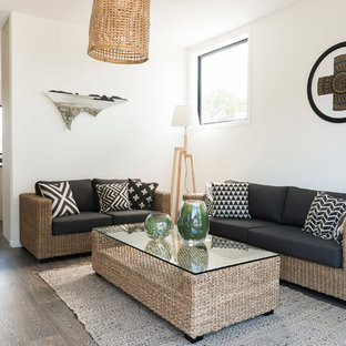 Nautical living room in Auckland with white walls, dark hardwood flooring and black floors.