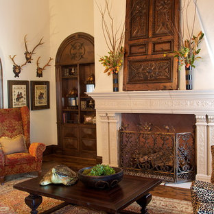 Inspiration for a mediterranean open concept medium tone wood floor living room remodel in Dallas with beige walls, a standard fireplace and a stone fireplace