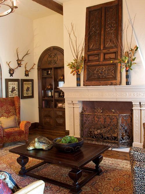 mediterrane wohnzimmer mit kaminsims aus stein ideen design bilder houzz. Black Bedroom Furniture Sets. Home Design Ideas