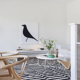 Inspiration for a small scandinavian open concept light wood floor living room remodel in Malmo with white walls, no fireplace and no tv