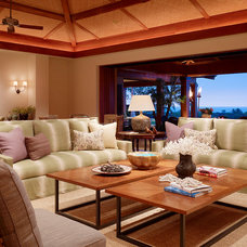 Tropical Living Room by GM Construction, Inc.