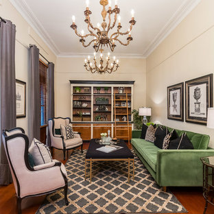 Inspiration for a traditional formal enclosed living room in Brisbane with beige walls, medium hardwood floors, no tv and brown floor.
