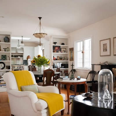 Inspiration for an eclectic enclosed living room library remodel in Los Angeles with white walls