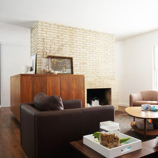Living room - modern living room idea in Minneapolis with a standard fireplace and a brick fireplace