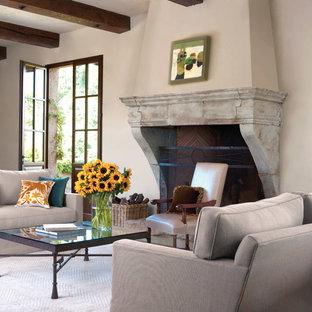 サンフランシスコの大きい地中海スタイルのおしゃれな独立型リビング (ベージュの壁、フォーマル、カーペット敷き、標準型暖炉、石材の暖炉まわり、テレビなし、白い床) の写真