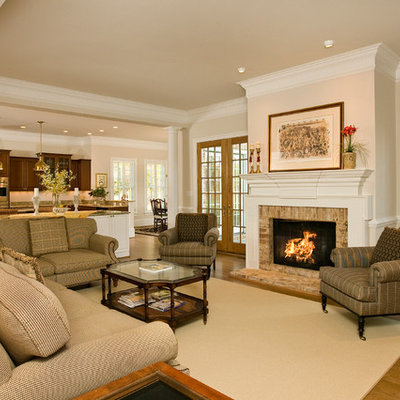 Inspiration for a timeless open concept medium tone wood floor living room remodel in Richmond with beige walls, a standard fireplace and a brick fireplace