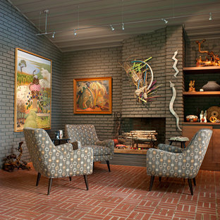 Living room - mid-sized midcentury modern formal and enclosed brick floor and red floor living room idea in Other with gray walls, a standard fireplace, a brick fireplace and no tv