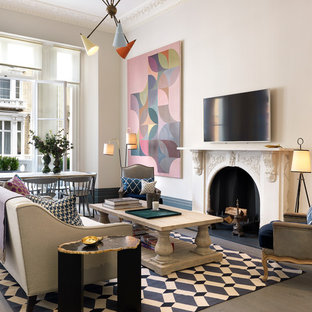 Design ideas for a contemporary open plan living room in London with white walls, light hardwood flooring, a standard fireplace, a wall mounted tv and grey floors.