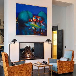 ロンドンの巨大なヴィクトリアン調のおしゃれなLDK (フォーマル、白い壁、濃色無垢フローリング、両方向型暖炉、石材の暖炉まわり、テレビなし) の写真