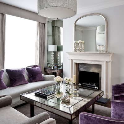 Large elegant open concept dark wood floor living room photo in London with white walls, a standard fireplace and a metal fireplace