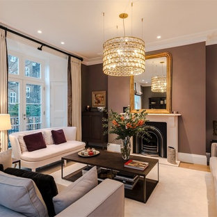 Medium sized traditional enclosed living room in London with brown walls, light hardwood flooring, a standard fireplace, a stone fireplace surround and beige floors.