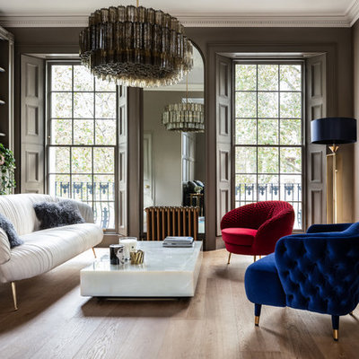 Inspiration for a large contemporary formal light wood floor living room remodel in London with a standard fireplace, no tv and brown walls