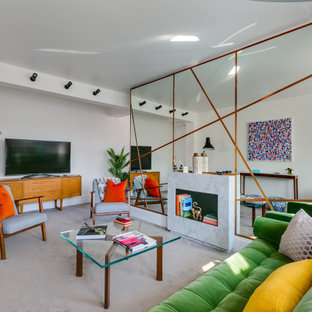 Design ideas for a large contemporary living room in London with white walls, carpet, a freestanding tv and grey floors.