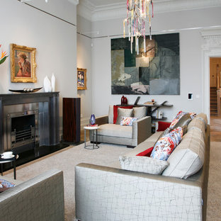 Living room - contemporary formal medium tone wood floor living room idea in London with gray walls, a standard fireplace and a metal fireplace
