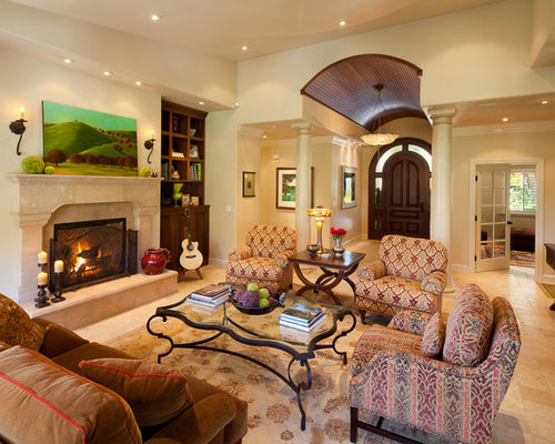 Mid Sized Traditional Enclosed Travertine Floor And Beige Living Room Idea In San Luis
