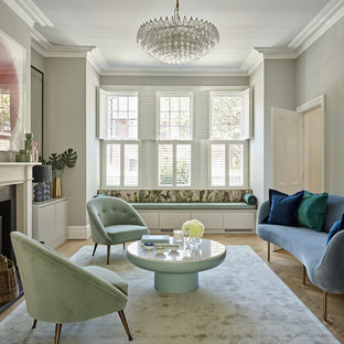 Traditional formal enclosed living room in London with grey walls, light hardwood flooring and brown floors.