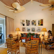 Tropical Living Room by GIL WALSH INTERIORS