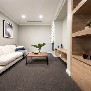 Photo of a contemporary living room in Perth with carpet, grey walls and no fireplace.