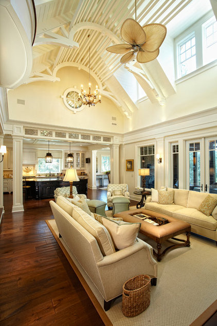 Tropical Living Room by Camens Architectural Group, LLC
