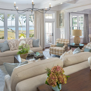 Example of a coastal open concept dark wood floor and brown floor living room design in Charleston with beige walls