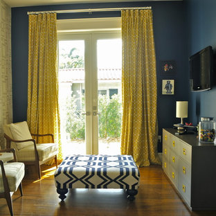 Example of a small classic living room design in Miami with blue walls