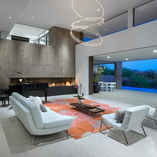 This is an example of a large modern formal open concept living room in Phoenix with white walls, a ribbon fireplace, a concrete fireplace surround, concrete floors, no tv and grey floor.