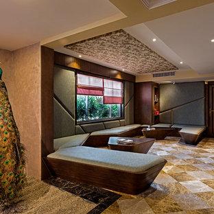 Imagen de salón contemporáneo con suelo multicolor